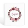 Gästbok med vinröda blommor