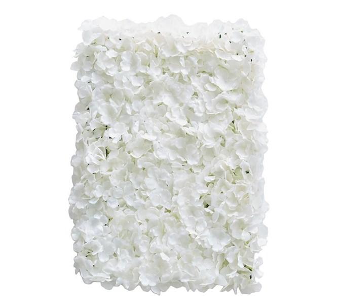 Blomvägg med vita blommor
