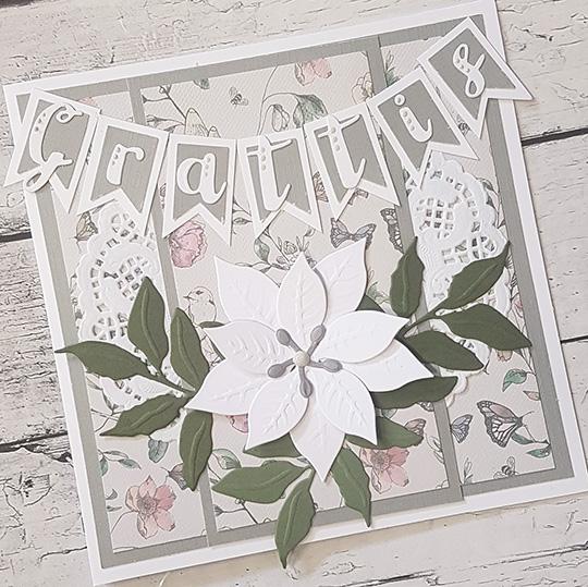 Grattiskort med grå blomster