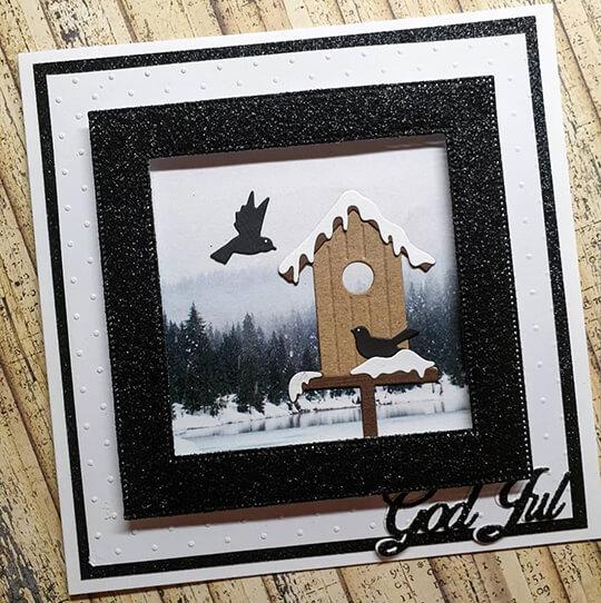 Julkort med svart glitterram